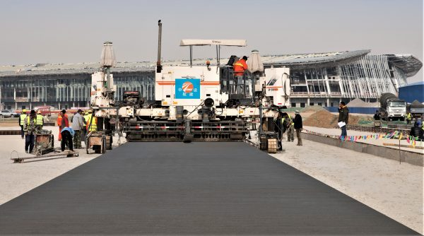 WIRTGEN SLIPFORM PAVERS LAYING PAVEMENTS FOR BEIJING NEW INTERNATIONAL AIRPORT
